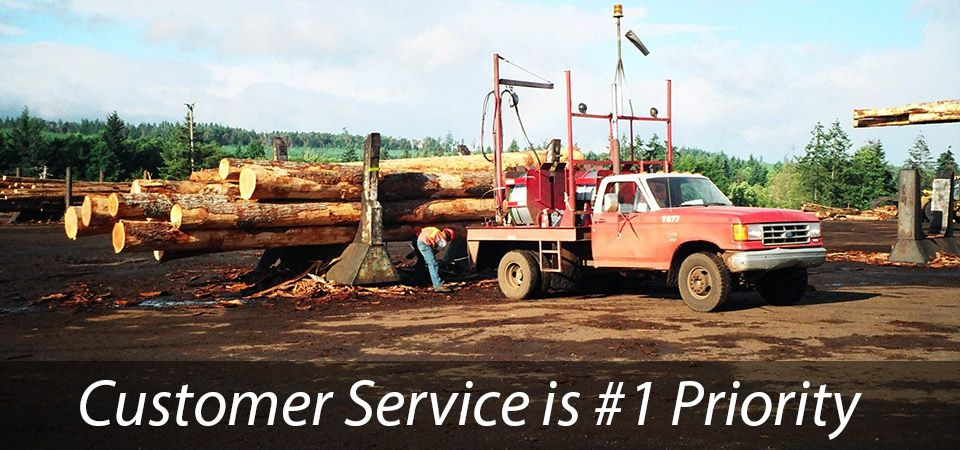 Customer Service is #1 Priority - logs on red truck