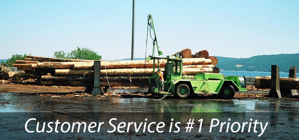 Customer Service is #1 Priority - logs on green truck
